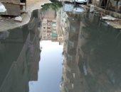 صور.. استمرار معاناة سكان شارع عرفة بالمريوطية الهرم من مياه المجارى