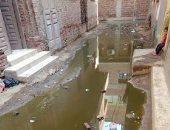 صور.. مياه الصرف الصحى تحاصر أحد شوارع قرية برنشت فى الجيزة