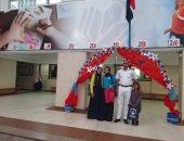 صور.. ضباط شرطة يصطحبون بنات الشهيد هشام العزب فى أول أيام الدراسة