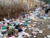 طلاب مدرسة بمساكن فيصل يستغثون لرفع القمامة من أمام مدرستهم