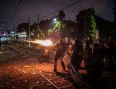 اشتباكات بين الشرطة والمتظاهرين فى أندونيسيا لليوم الثالث على التوالى