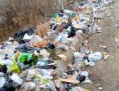 شكوى من انتشار القمامة بجوار سور مدرسه نجيب محفوظ بمساكن فيصل بالجيزه