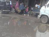 أهالى ترسا بالجيزة يشكون من انتشار مياه الصرف بالشارع العمومى