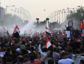 متظاهرون يتوافدون على ساحة التحرير ببغداد والقوات الأمنية تحاول تفريقهم