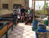"""""""بالنعناع والريحان"""".. طلاب الجامعة الأمريكية يؤسسون حديقة على سطح مبنى بالحطابة"""
