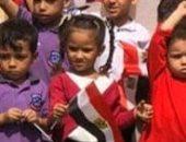 احتفال أحد المدارس بالهضبة الوسطى بانتصارات أكتوبر بعلم مصر
