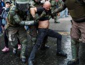 صور.. اشتباكات عنيفة مع الشرطة فى تشيلى خلال مسيرة يوم كولومبوس