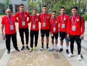 صور.. وصول المنتخب العسكرى للصين للمشاركة فى كأس العالم