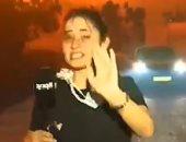 شاهد.. مراسلة لبنانية تبكى عند سماع صرخات سكان محاصرين بالنيران
