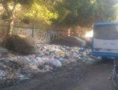 تلال القمامة تغرق شارع عزت باشا بالمطرية