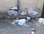 قارئ يشكو من انتشار القمامة بسور نادى سبورتنج بالإسكندرية