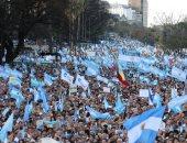 مؤيدو ماوريسيو ماكرى يتظاهرون لدعمه بجولة الإعادة بالانتخابات الرئاسية بالأرجنتين