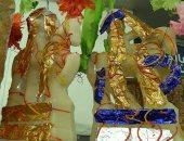 عروسة وحصان من السكر.. قارئ يشارك بصور لحلوى المولد