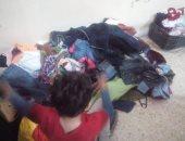 """صور.. متطوعون بشمال سيناء يطلقون مبادرة """"ملابس الشتاء تدفئ الجميع"""""""