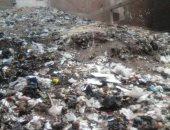 """""""جبل من المخلفات"""".. سكان أحد شوارع حى السلام أول يشكون من تراكم القمامة"""