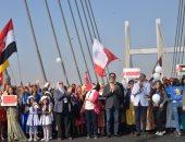 """وزير الشباب والرياضة يشهد أول """"ديفليه"""" لأطفال العالم أعلى كوبرى """"تحيا مصر"""""""