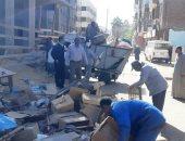 صور.. الوحدة المحلية بإدفو تنفذ حملة مكبرة لإزالة الإشغالات