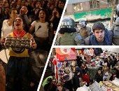 """صور.. العالم هذا الصباح.. عنف متبادل وحملة اعتقالات واسعة بين متظاهرى تشيلى.. زحام بالمحال التجارية فى أمريكا بـ""""الجمعة السوداء"""".. مظاهرات كولومبيا تتحول إلى كرنفال موسيقى"""