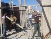صور .. إيقاف بناء 9 عقارات مخالفة وغلق 3 محلات بأحياء الإسكندرية