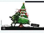 كاريكاتير الصحف الفلسطينية: جندى اسرائيلى يفخخ شجرة عيد الملاد