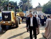 حى الدقى يزيل الإشغالات بشارع التحرير وكوبرى الخشب.. صور