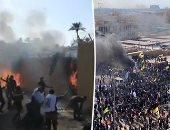 """""""الموت لأمريكا"""".. محتجون عراقيون يقتحمون حرم السفارة الأمريكية فى بغداد.. المتظاهرون يحرقون العلم الأمريكى وإحدى بوابات المبنى الدبلوماسى..والموظفون يغادرون المقر.. والأمن يكتفى بإطلاق الغاز المسيل.. فيديو وصور"""