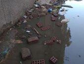 صور ..مياه الصرف الصحى تحاصر سكان شارع بمنطقة فى المرج