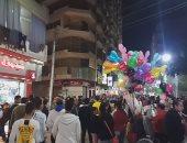 فيديو وصور .. زحام شديد بشوارع أسيوط وانتشار أمنى مكثف احتفالا برأس السنة