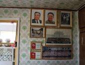 """أم كورية شمالية مهددة بالسجن لإنقاذها أطفالها من حريق بدلا من صور """"كيم"""""""