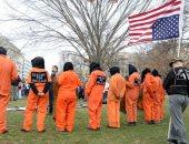 متظاهرون بواشنطن يطالبون بغلق سجن جوانتانامو خلال إحياء ذكرى افتتاحه الـ18.. صور