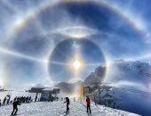 """صورة غير مسبوقة لـ """"هالة جليدية"""" حول الشمس بجبال الألب من كاميرا هاتف"""