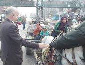 حى شرق شبرا الخيمة يسلم سيدة الكارو عربتها وتتعهد بعدم نبش القمامة