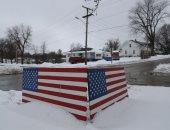 عاصفة ثلجية تجتاح ولاية آيوا الأمريكية.. و الجليد يكسو المنازل والشوارع