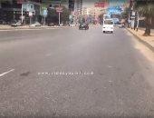 انتظام الحركة المرورية بشارع التحرير فى الجيزة وسط تواجد رجال المرور