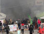 قوات الأمن العراقية تحرق خيام المتظاهرين بميدان التحرير وسط بغداد