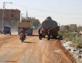 """صور.. بدء رصف طريق """"الدير المحرق"""" إحدى محطات مسار رحلة العائلة المقدسة بأسيوط"""