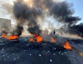 متظاهرون يقطعون الطريق اعتراضاً على تكليف علاوى بتشكيل الحكومة العراقية الجديدة