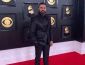 صور.. محمد كريم على السجادة الحمراء لحفل توزيع جوائز Grammy