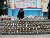 تفاصيل مصادرة الشرطة الصينية حيوانات تباع سرا من خلال تطبيق we chat.. صور