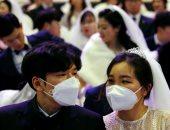 """الحب فى زمن """"كورونا"""".. حفل زفاف جماعى بـ""""الكمامات"""" فى كوريا الجنوبية"""