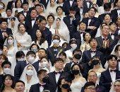 حفل زفاف جماعى يتحدى فيروس كورونا فى كوريا.. فيديو