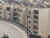 صور.. دهان عقارات طريق النصر وامتداد رمسيس فى القاهرة باللون الموحد