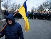 أوكرانيا: إصابة 9 من الشرطة فى هجوم على حافلة تقل مواطنين تم إجلاؤهم من ووهان