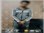 ضبط 570 جرام هيروين بحوزة تاجر مخدرات بالعمرانية