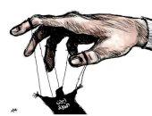 كاريكاتير صحيفة سعودية.. الحرس الثورى يتحكم فى الحكومة الإيرانية
