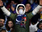 جماهير برشلونة ونابولى بالكمامات خوفا من كورونا