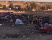 قارئ يناشد حى الهرم إزالة سوق عشوائى خلف المتحف الكبير بمساكن شباب الرماية
