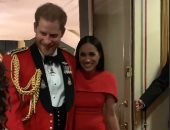 الأمير هارى وميجان يتزينان بالأحمر فى احتفالات ذكرى نهاية الحرب العالمية الثانية