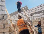 صور.. التحفظ على نصف طن أسمنت وإيقاف 4 حالات بناء مخالف بالإسكندرية
