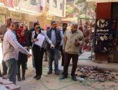 رصف شوارع حى شمال الجيزة ضمن خطة تطوير العشوائيات.. صور